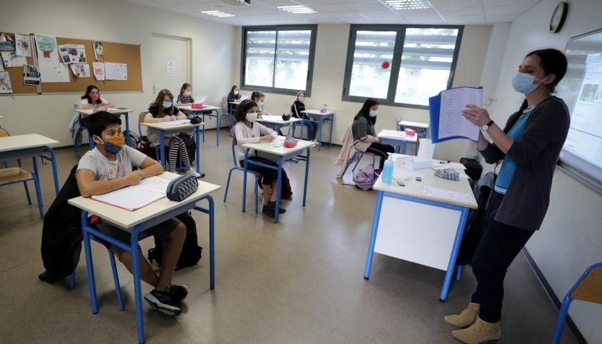 """Selon la circulaire de rentrée du ministère de l'Éducation nationale, """"tous les élèves seront accueillis sur le temps scolaire"""", dans """"le respect des règles sanitaires"""". //©Eric Gaillard / REUTERS"""
